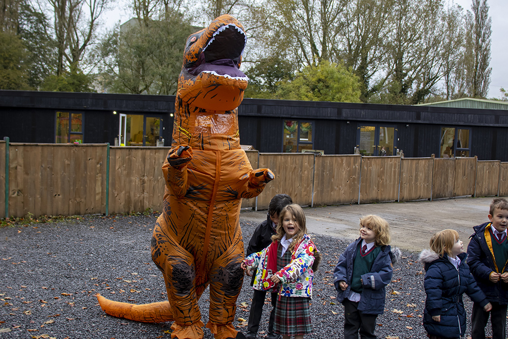 kids with t-rex costume