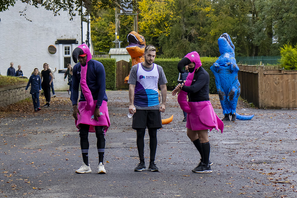 men in flamingo suits getting ready for run