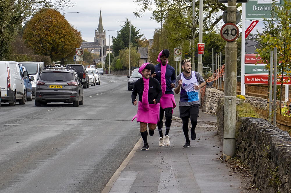 Runners in costumes along the pavement