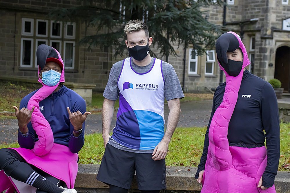Runners in costumes and masks