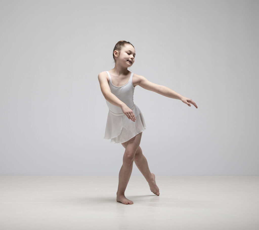 Young ballet dancer holding a pose