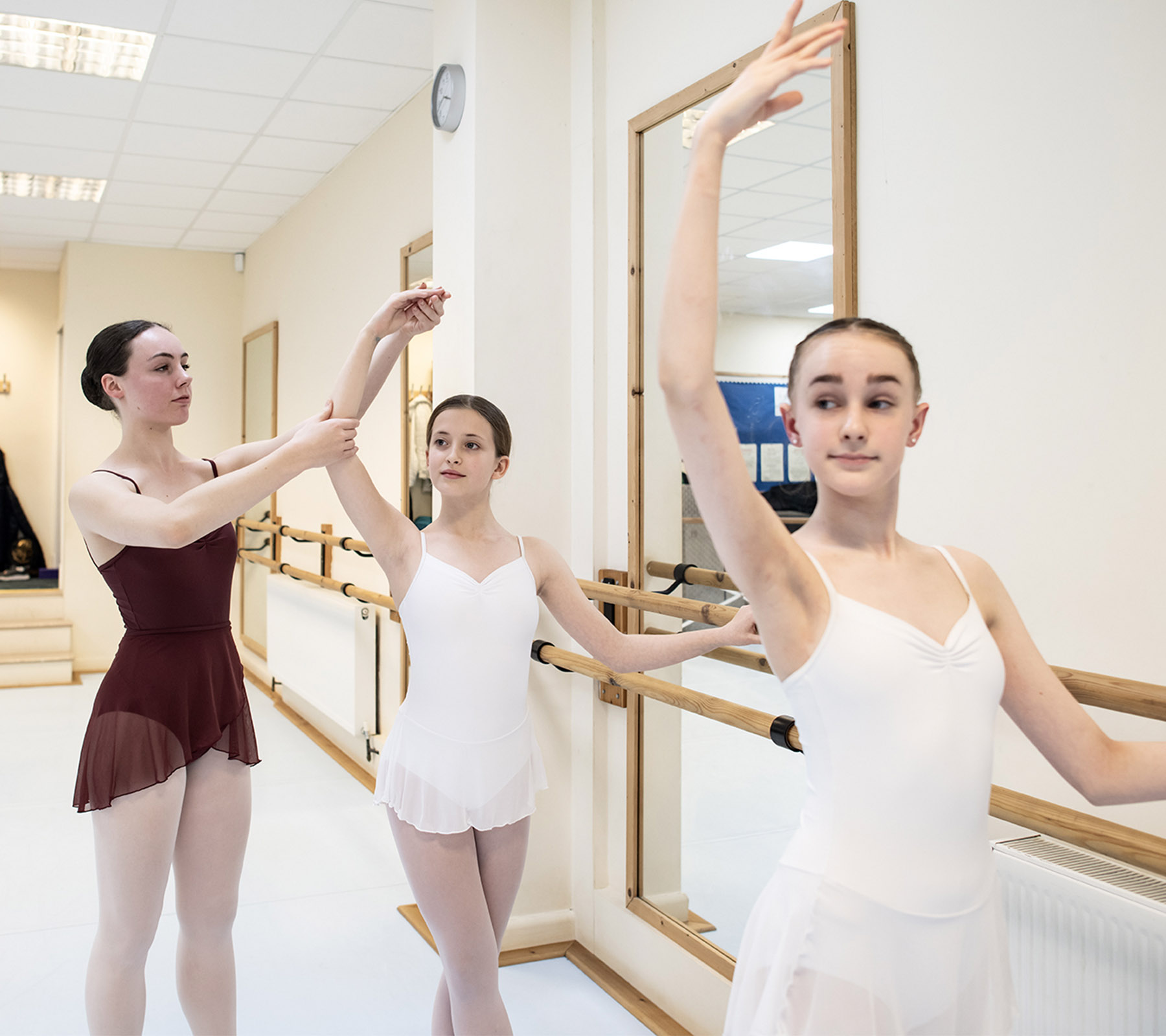 ballet students practicing with teacher