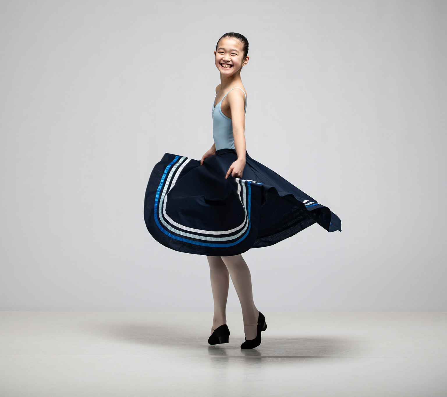 Dancer with large striped skirt