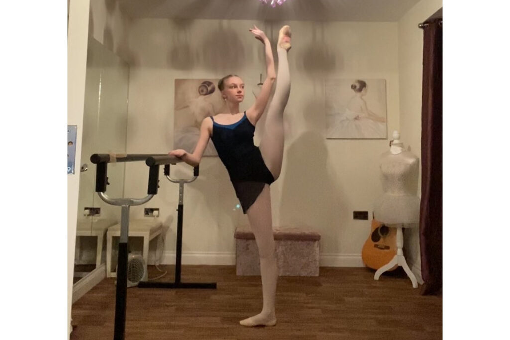 Hannah balancing with one leg up on zoom