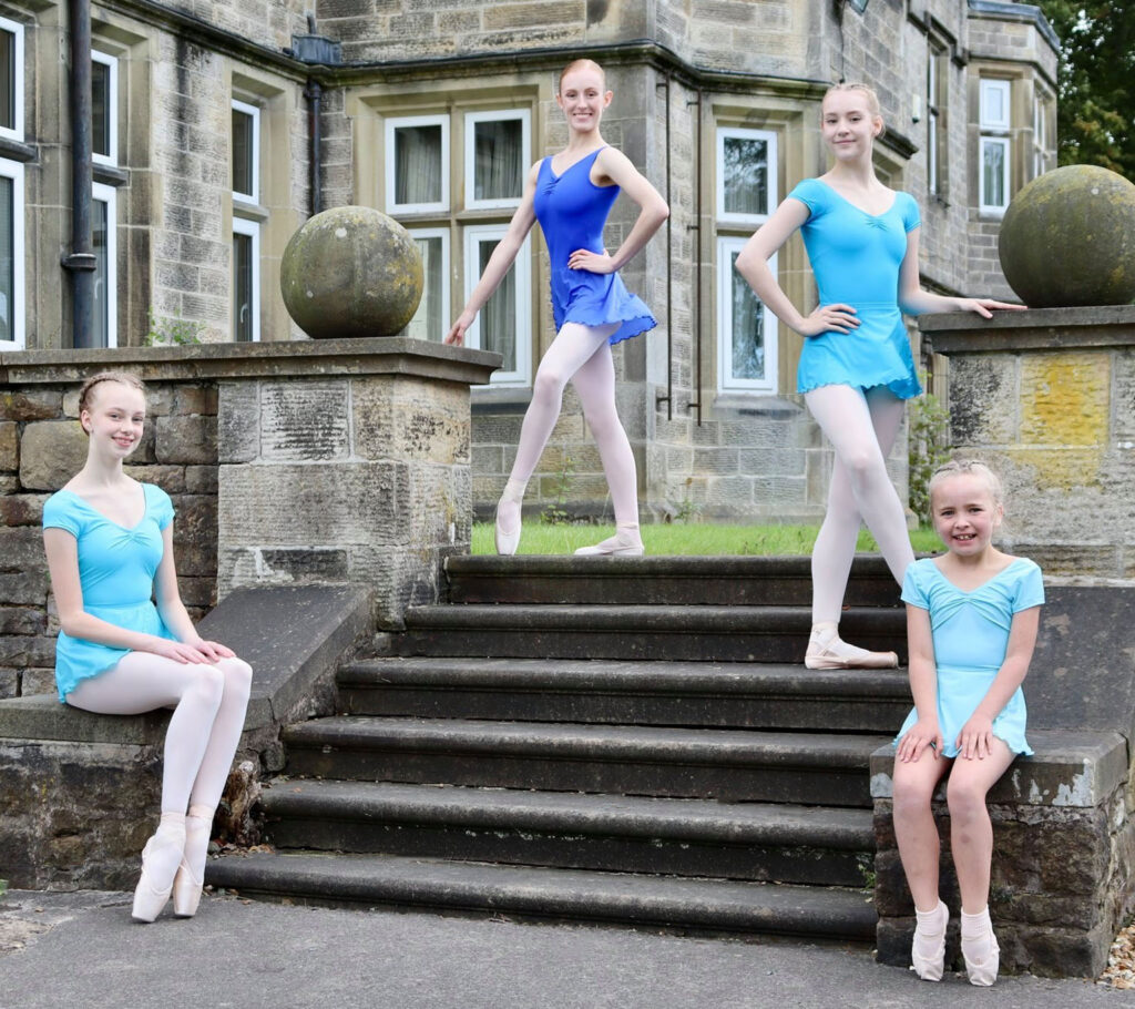Ballet students posing on stairs