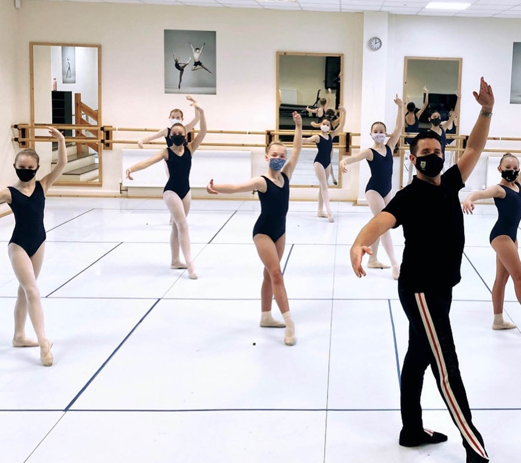 Students and teacher in class practicing moves