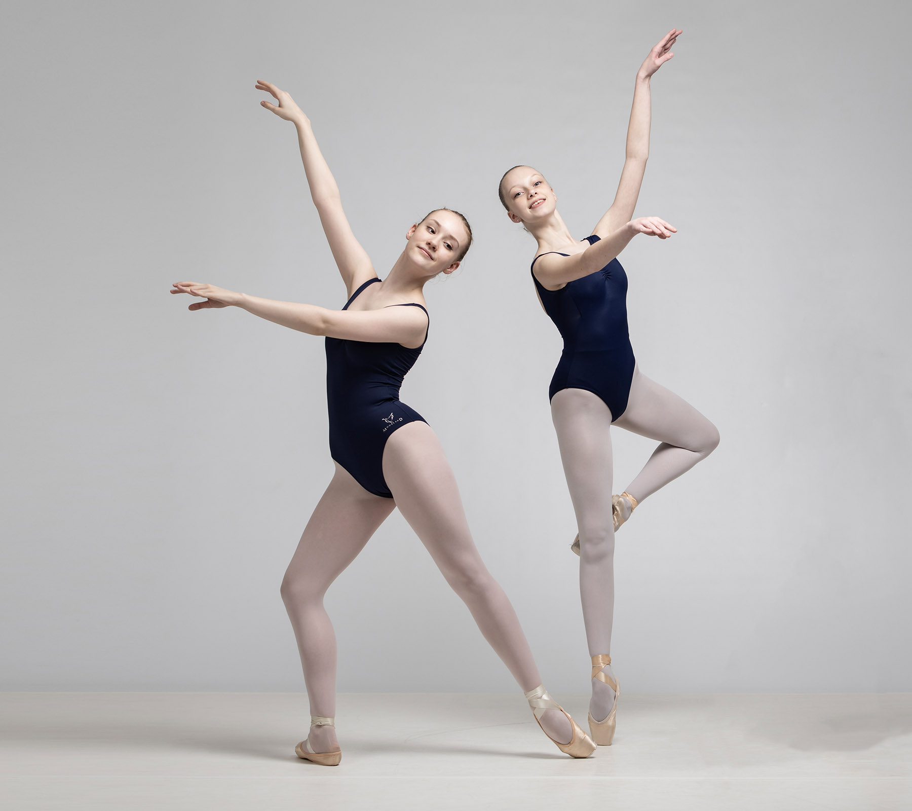 Two ballet students posing